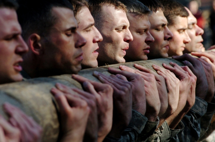 US_Army_soldiers_in_SFAS_class_04-10_participates_in_log_and_rifle_PT_at_Camp_MacKall_on_Wednesday_January_13_2010.